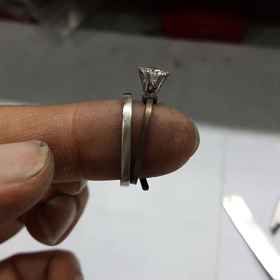 Trapezoid shape wedding ring sitting along side client engagement ring (we had to add a little more metal to shank)