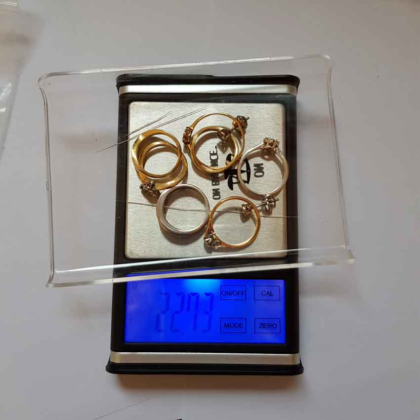 Clients old gold diamond rings being weight for metal content