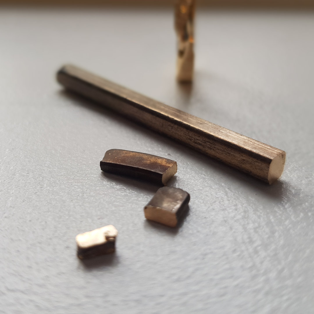 Melted gold jewellery combined into metal bar.