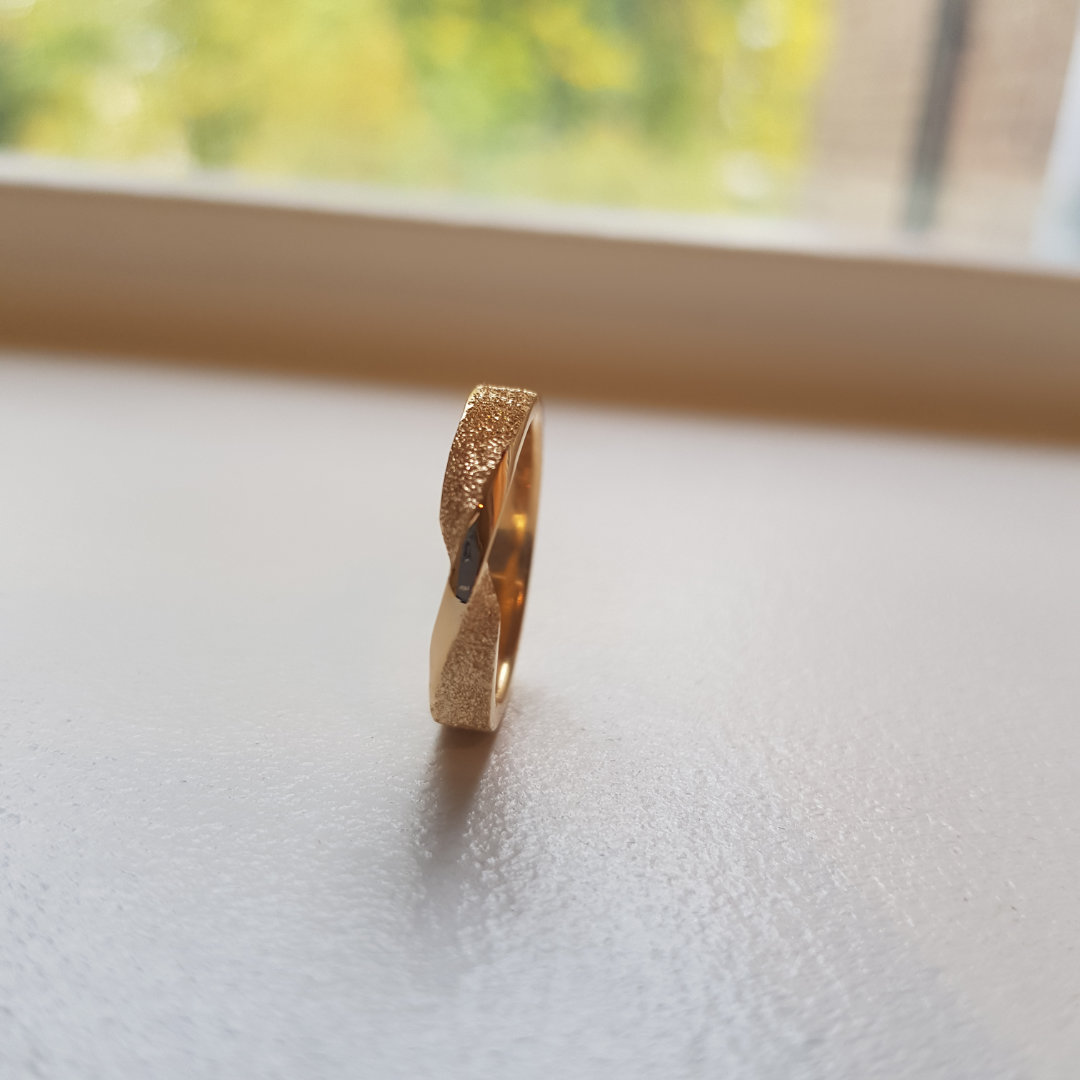 Mobius twist ring made from old gold jewellery.