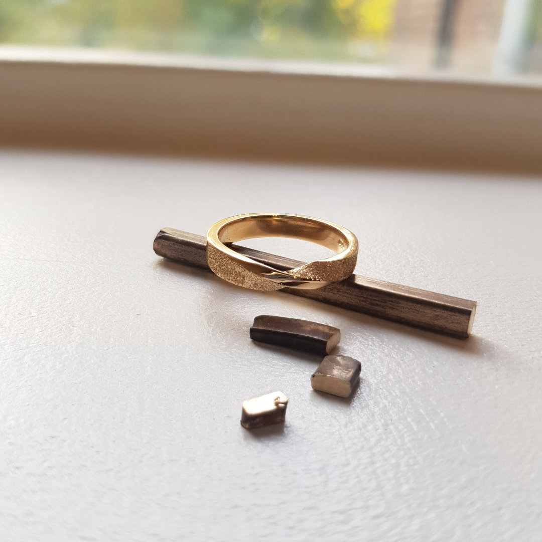 The end of a jewellery remodelling project - a gold Moebius twist ring made with gold jewellery.