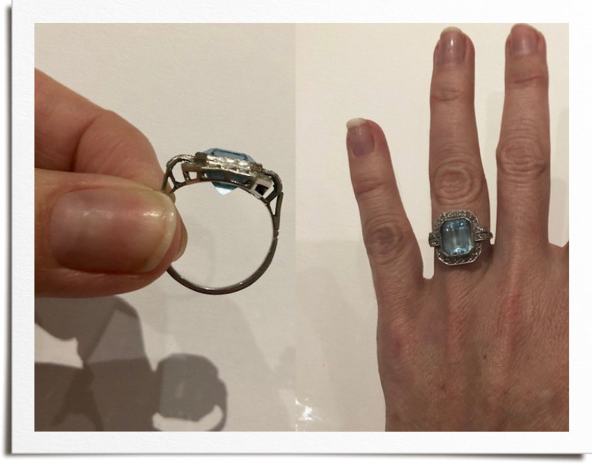 Original vintage ring with platinum and aquamarine pre remodelling. Tip of aquamarine sticking out bottom of setting.