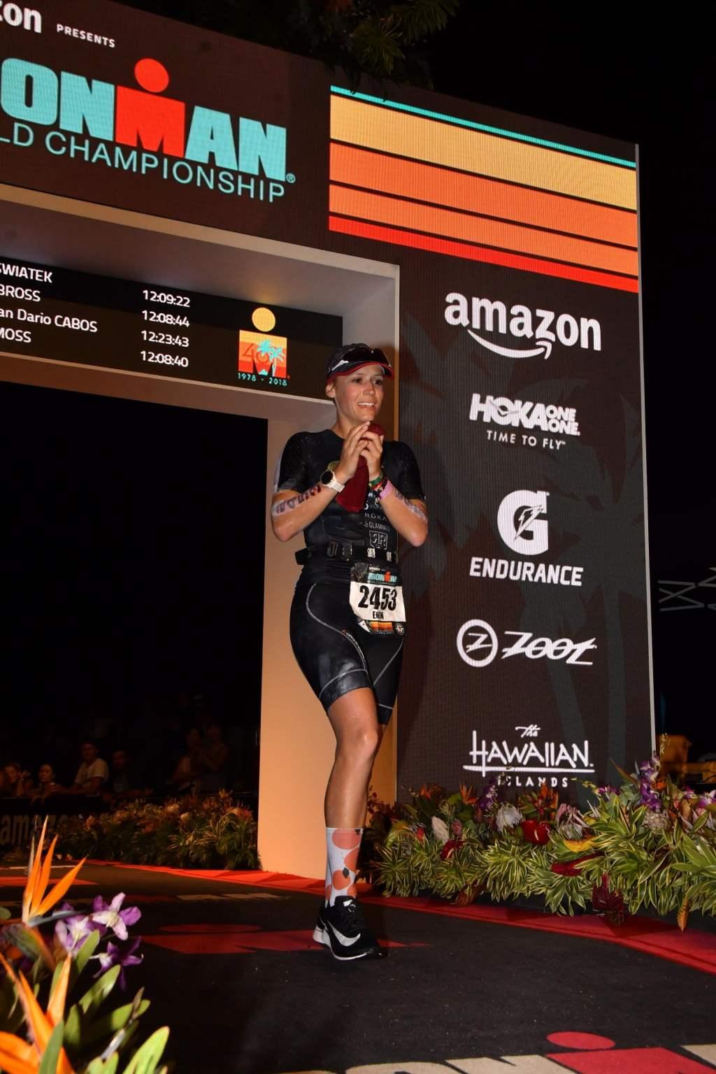 Erin Swiatek crossing the finish line at the IRONMAN World Championships.