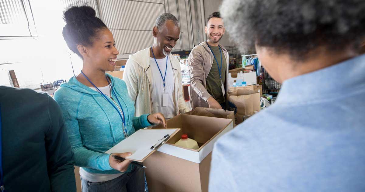 Group of volunteers; woman in blue shirt.