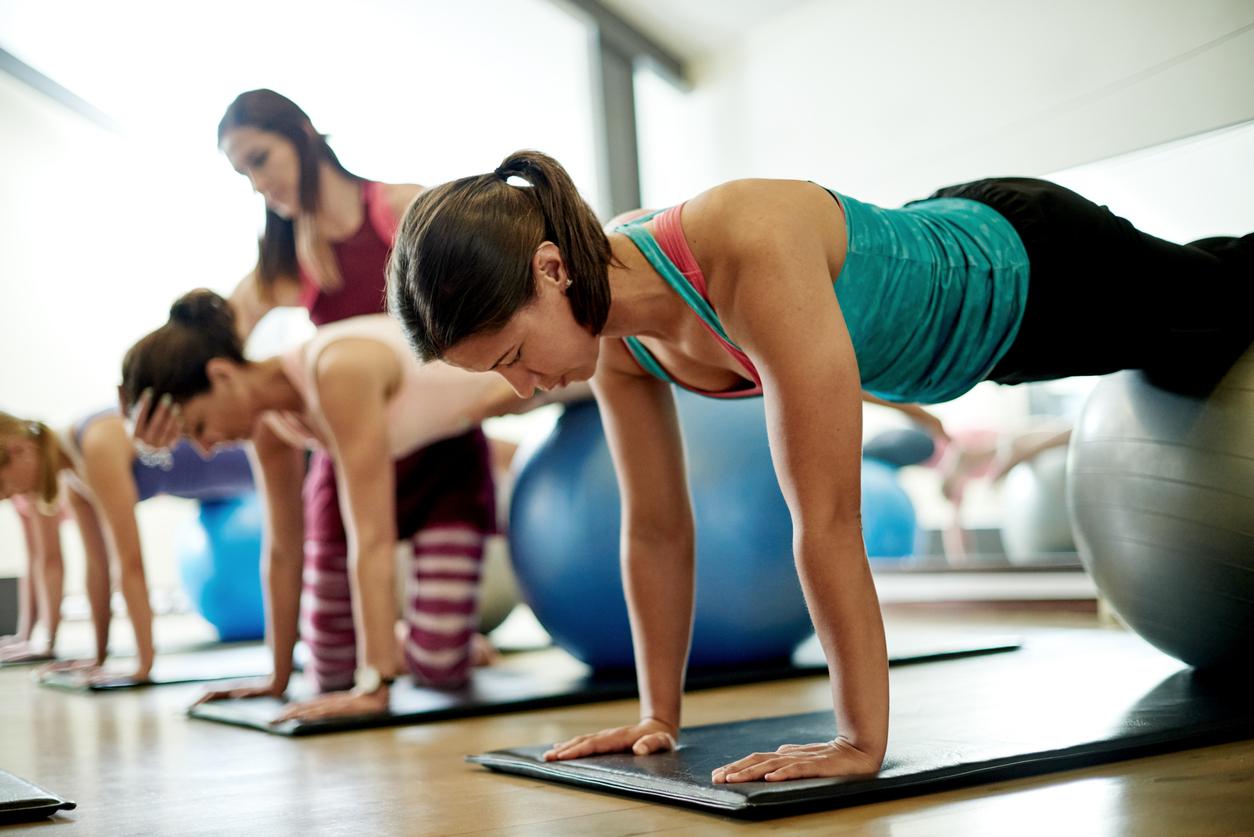 group of ladies doing yoga at yoga studio