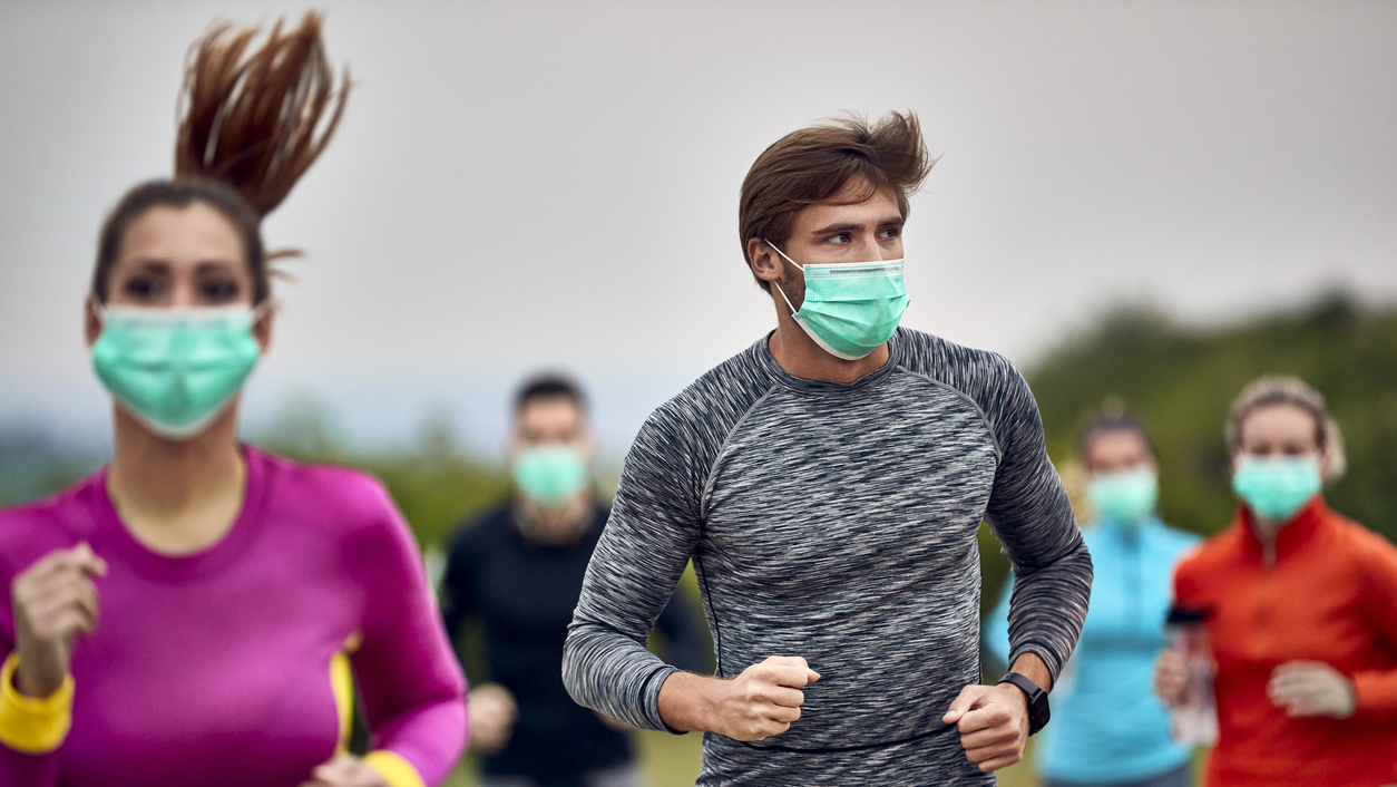 Runners racing in masks