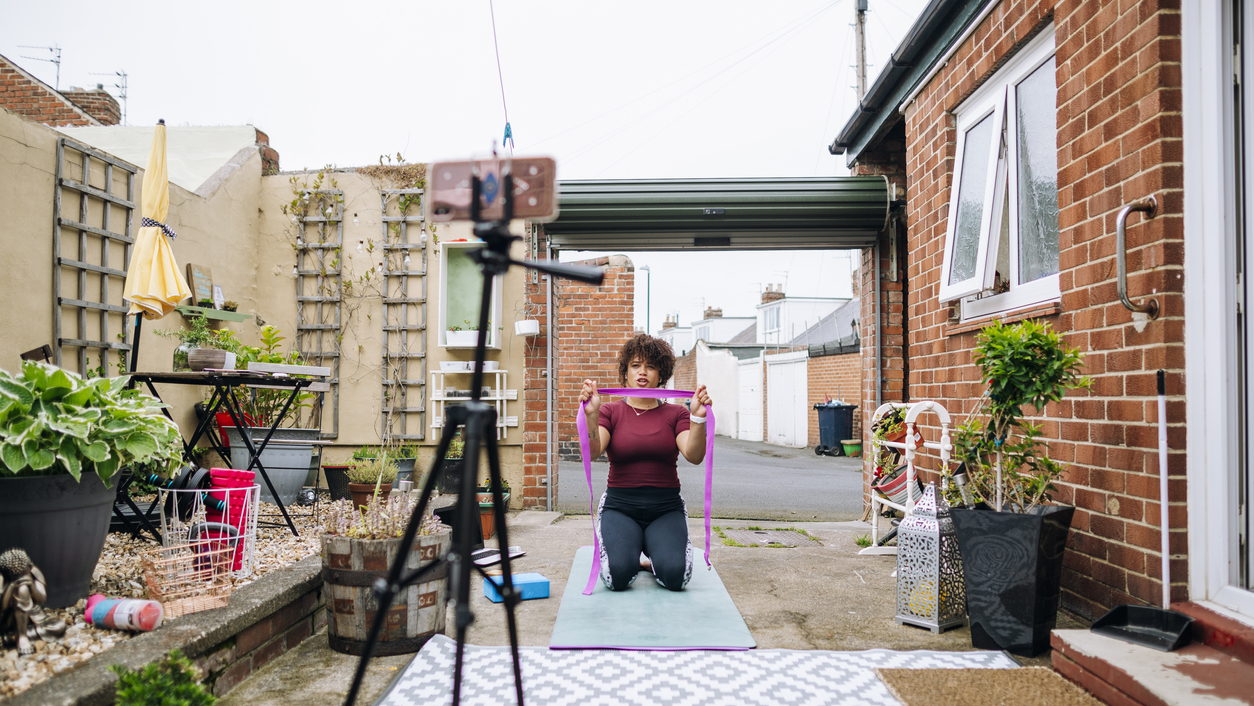 Exercise instructor shooting a video.