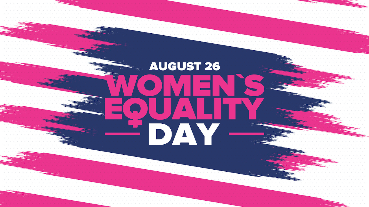 Pink and white diagonal stripes with blue center and August 26 Women's Equality Day written across patch of blue.