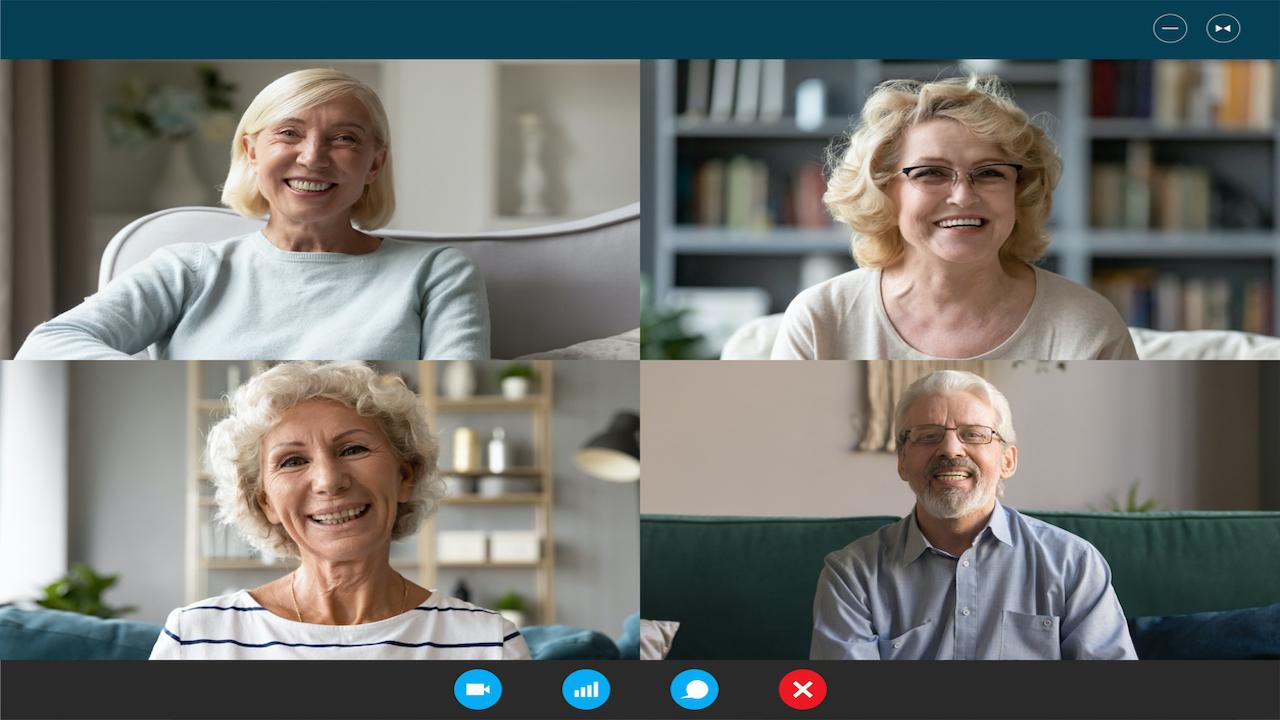 Four seniors virtually chatting on a computer.