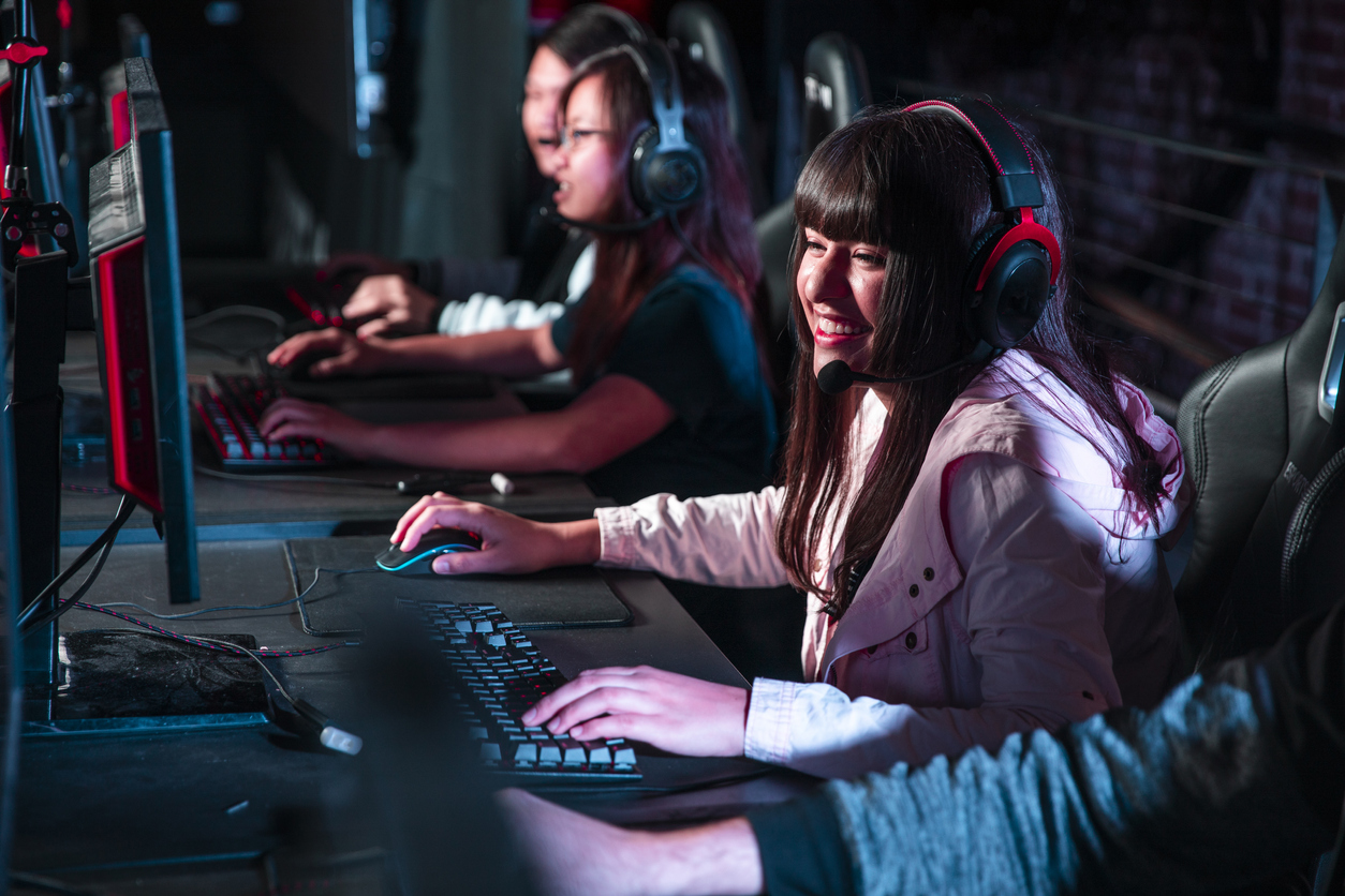 Teens playing eSports on their computers.