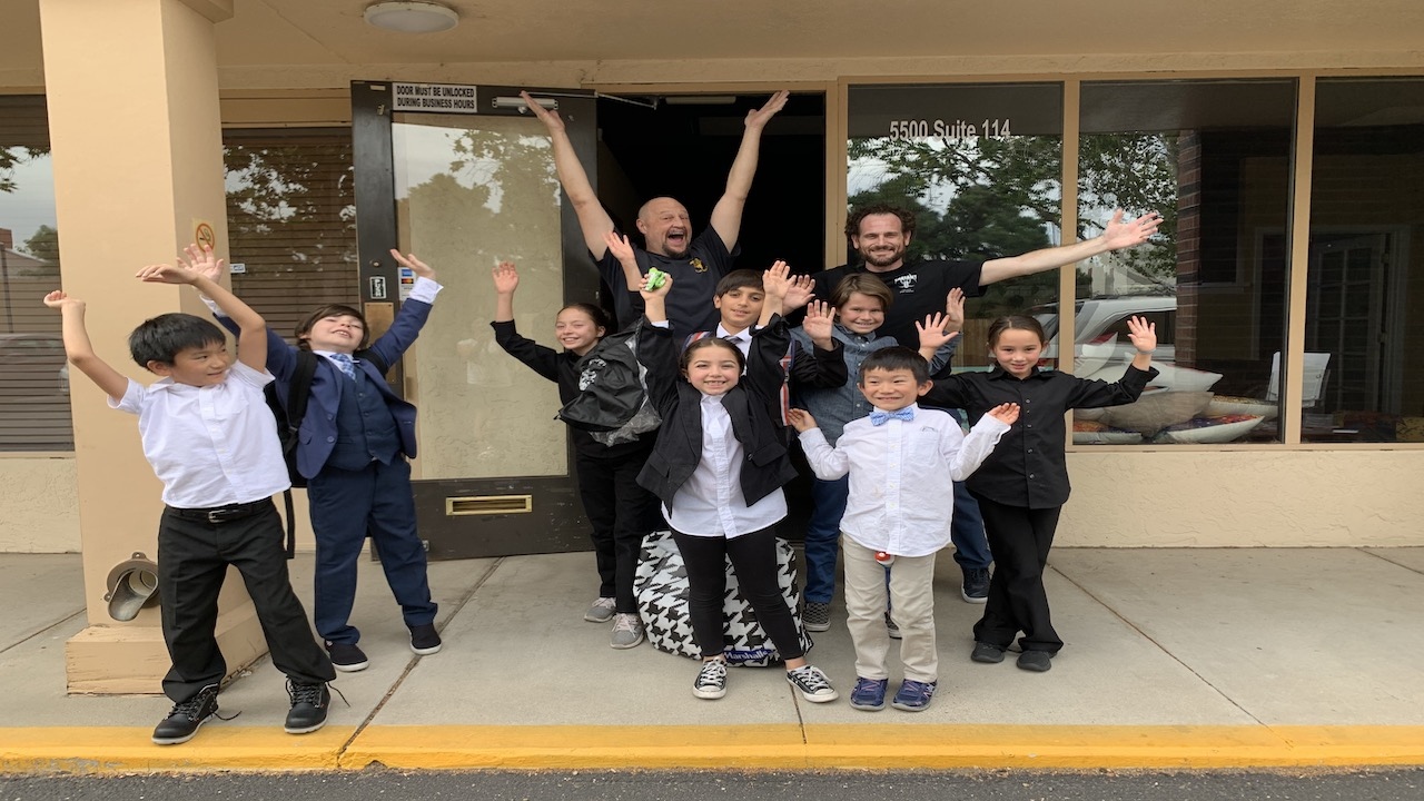 Students celebrate in front of Sol Acting Academy