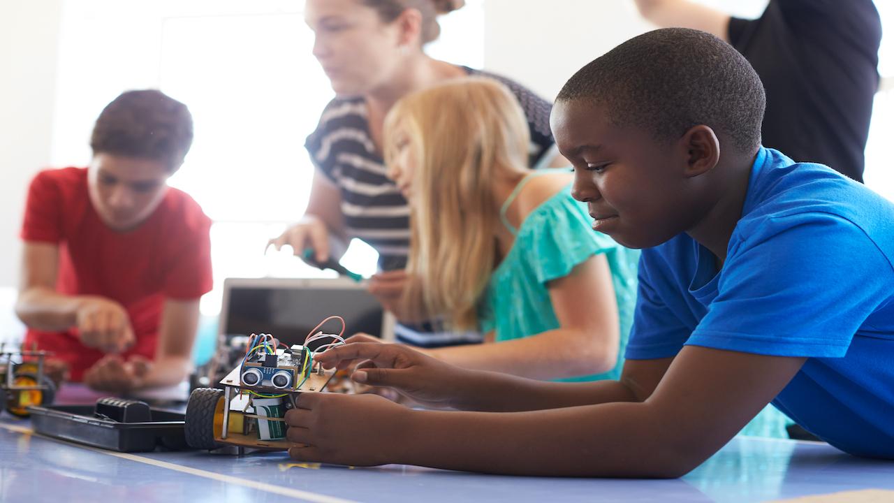 Children working together on a STEM robotics project.