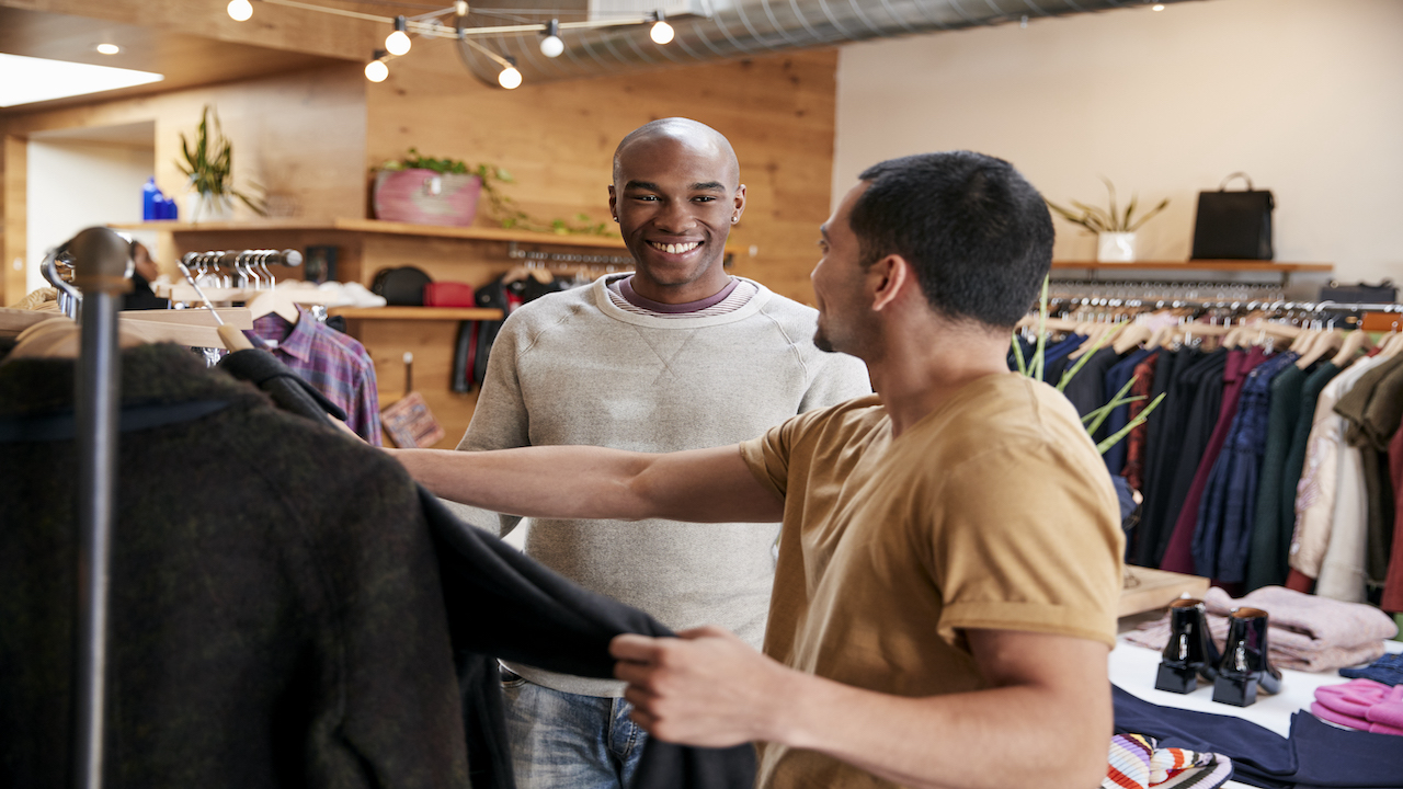 Two men shopping at a small business.