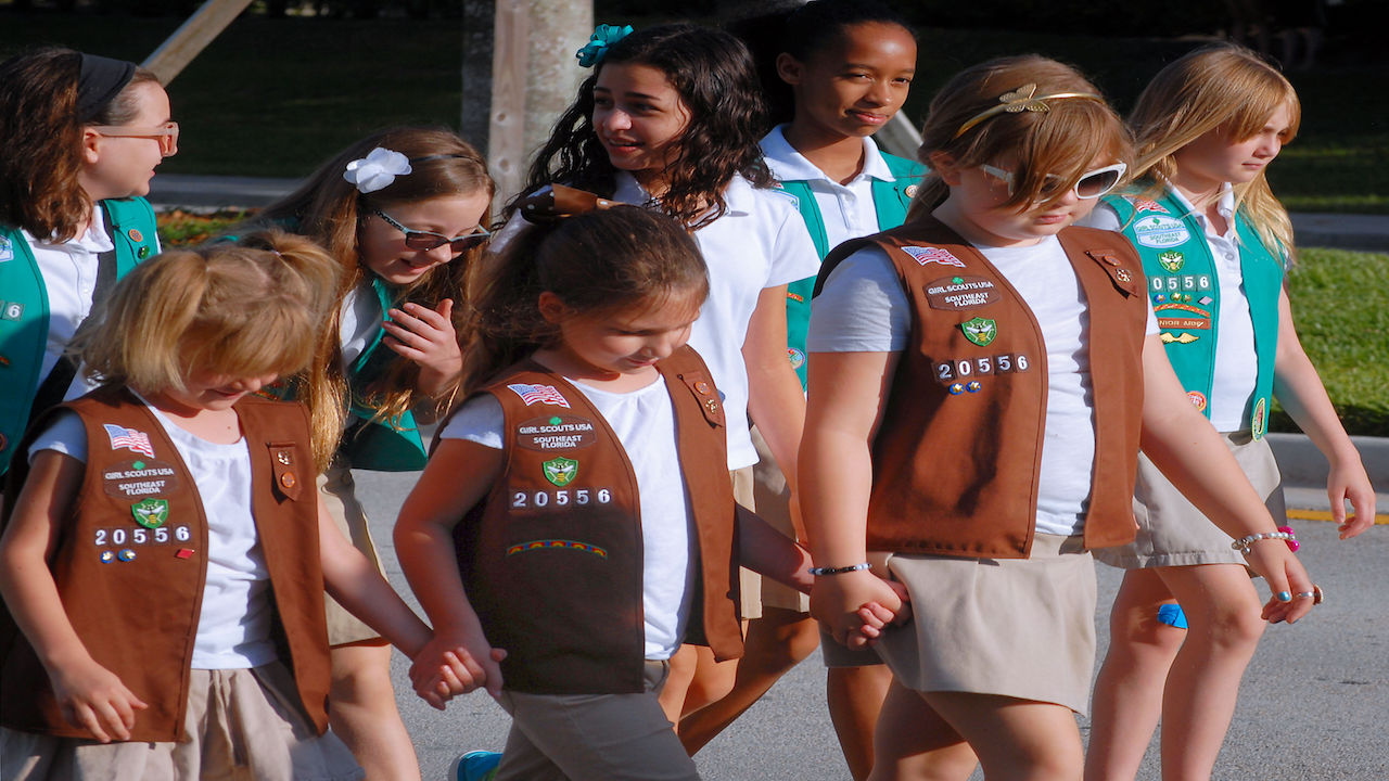 Group of Girl Scouts walking outside.