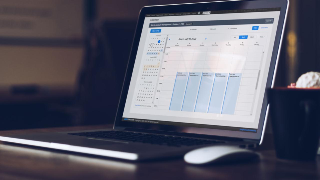 Laptop with JumpForward calendar on the screen.