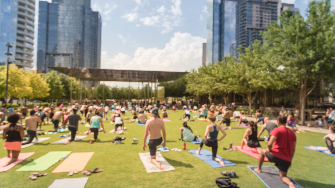 Yoga class at Klyde Warren Park in Dallas, Texas.
