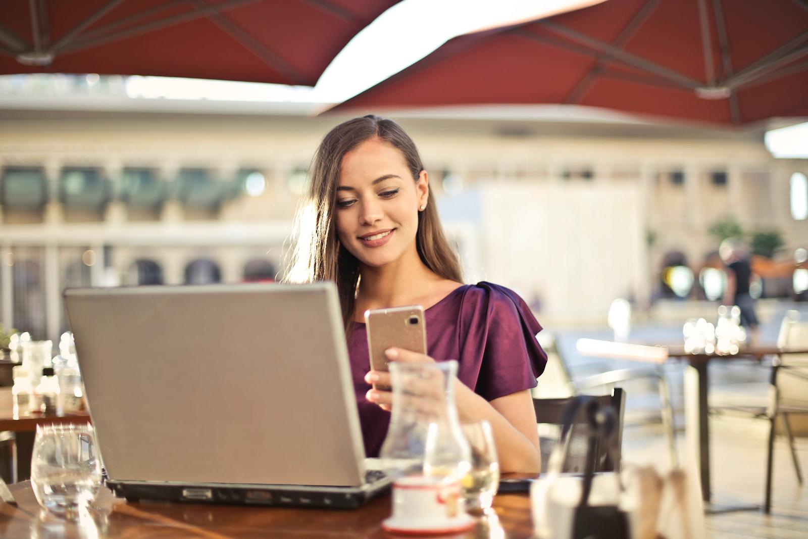 Woman phone laptop resturant