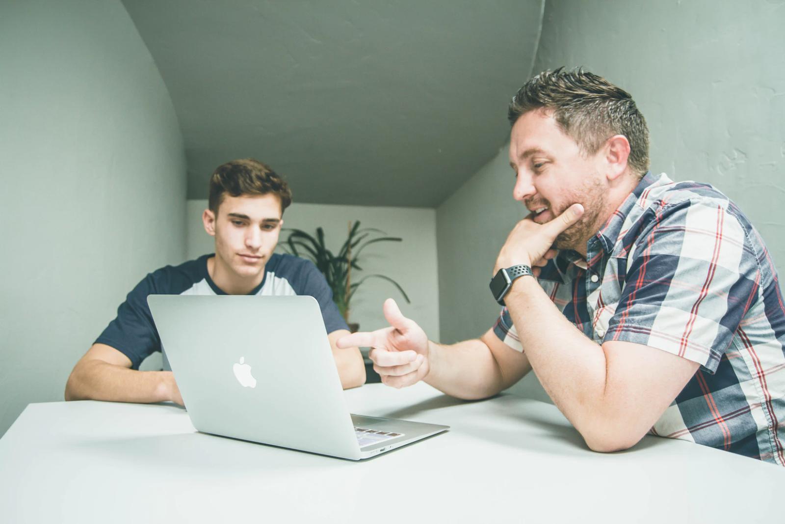 Men planning laptop