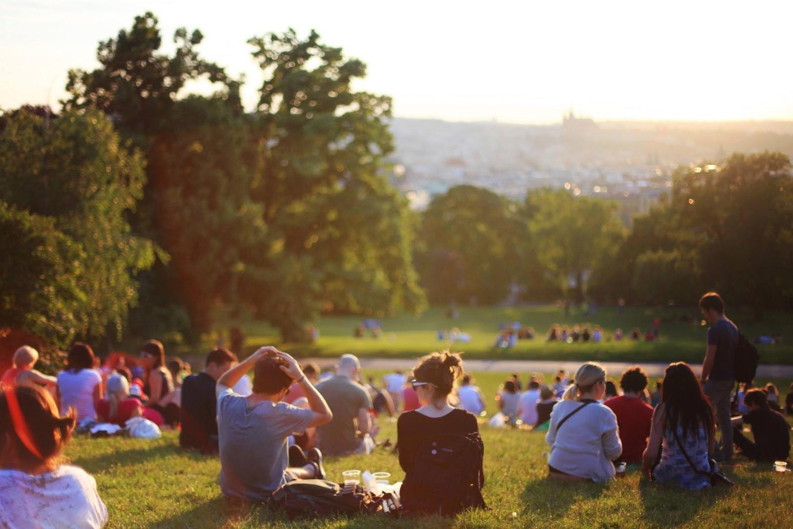 Millennials sit in a park