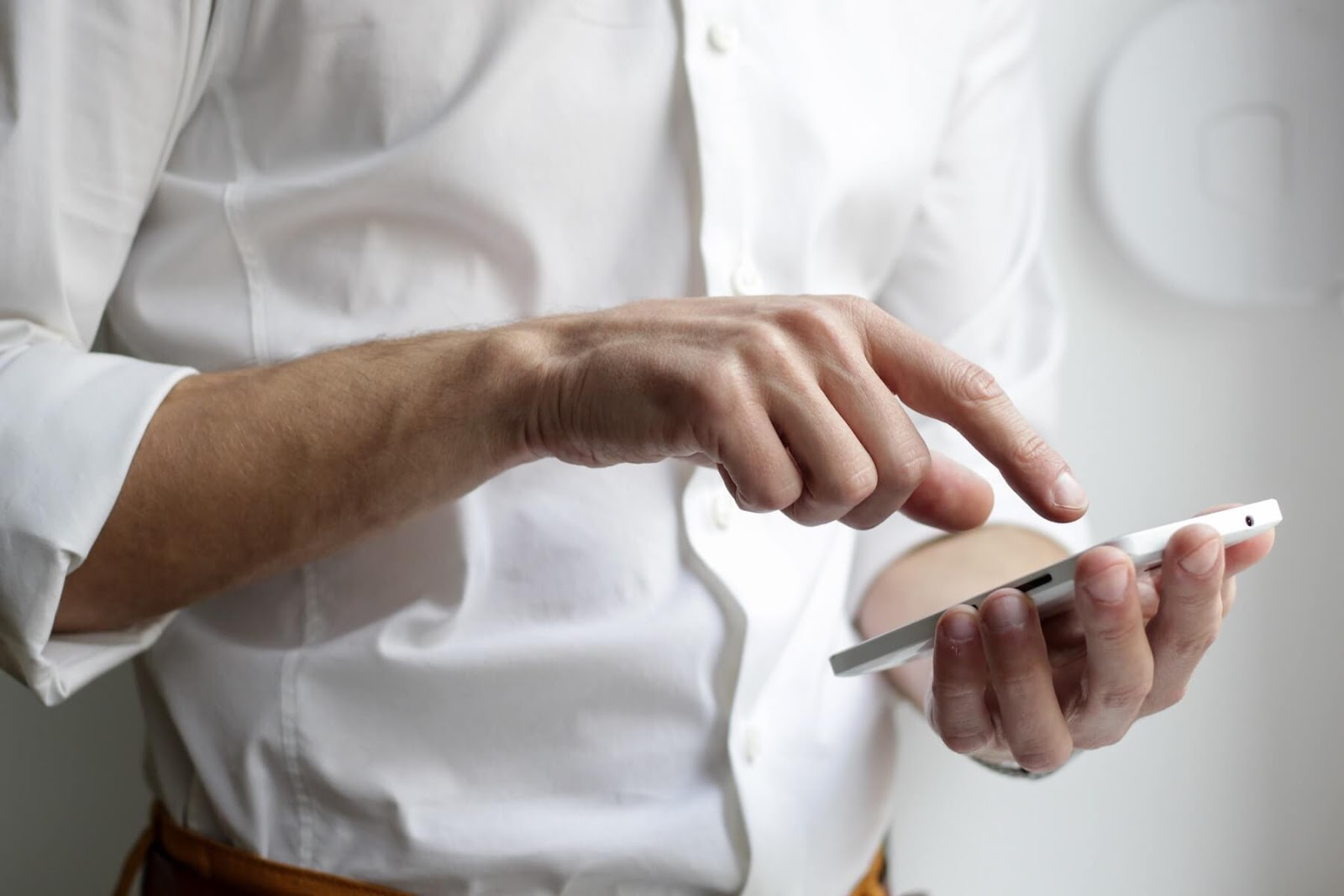 a person scrolling through the internet with their mobile phone.