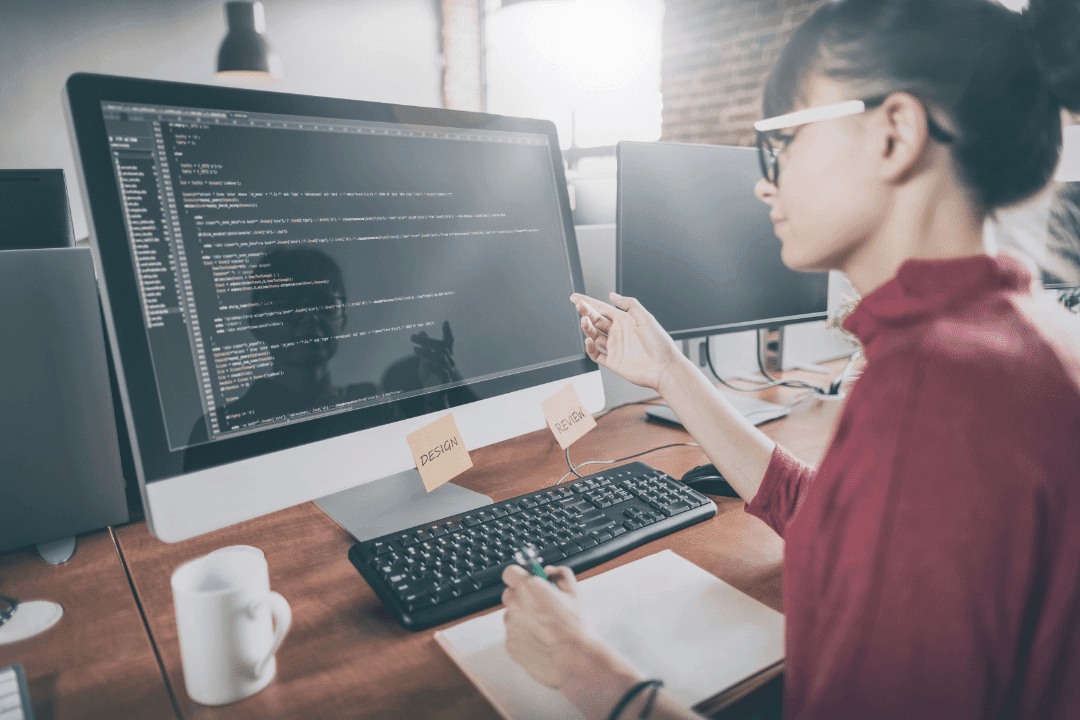 woman working at computer web design coding office
