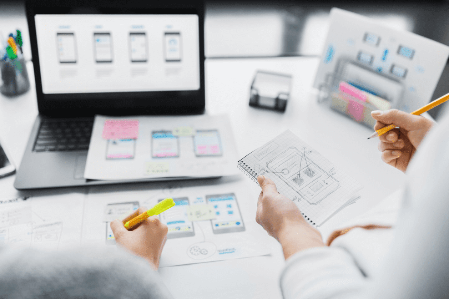 team of website designers works through the planning of regular website updates