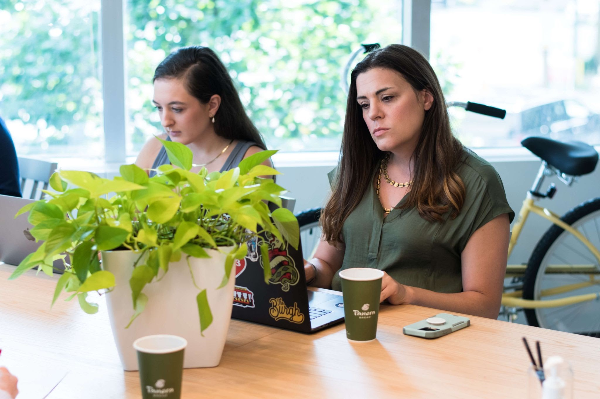 Two women looking at their computers