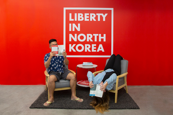 People reading books about North Korea.