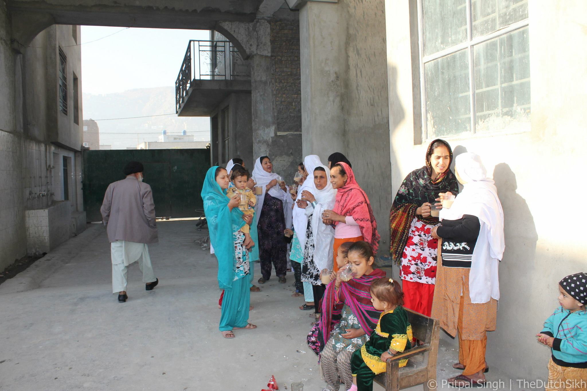 Women and children standing outside of Kabul's Gurduara Harirai Sahib in 2012. Photograph by Pritpal Singh.