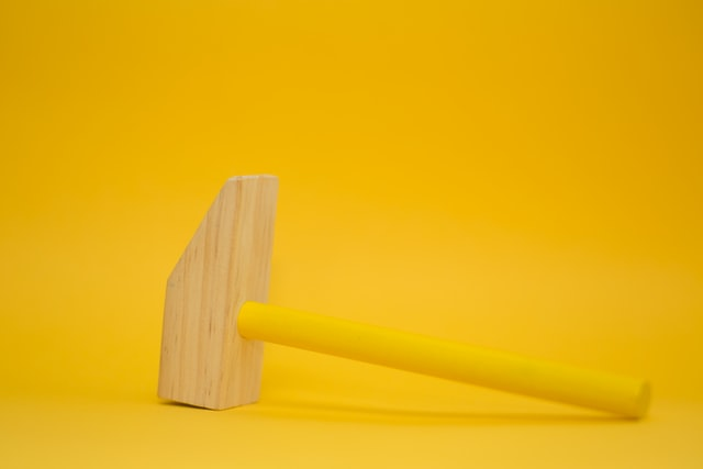 Large yellow wooden hammer