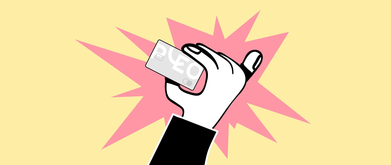 A hand holding a Pleo card