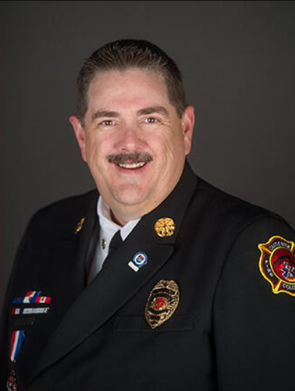 A photopgraph of the local official (Fire Chief, Emergency Manager, etc) explaining this Community Connect program to your city.