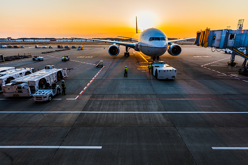 Image of a jet at an airport near sundown.
