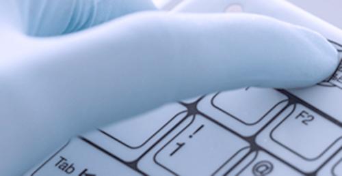 Gloved hand using Medigenic keyboard