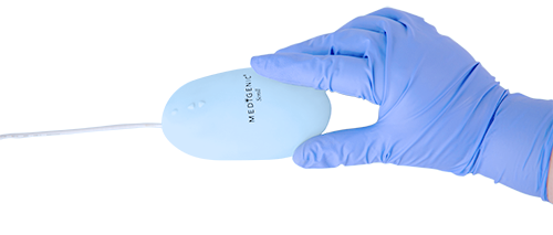 Gloved hand using a Medigenic washable mouse