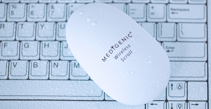 Medigenic mouse on a Medigenic keyboard with droplets of water.