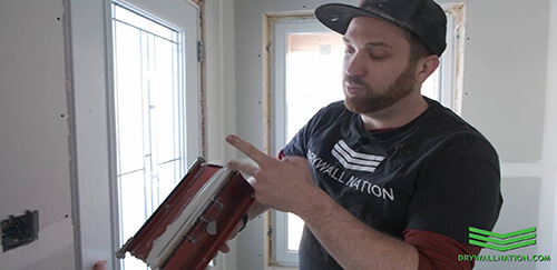 inspecting flat box joint compound on level5 drywall tool