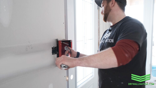 Drywall Nation showing how to use a drywall flat box when finishing wall plugs.
