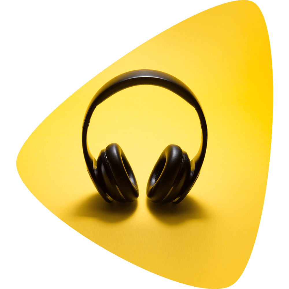 Over the ear headphones on a yellow background.