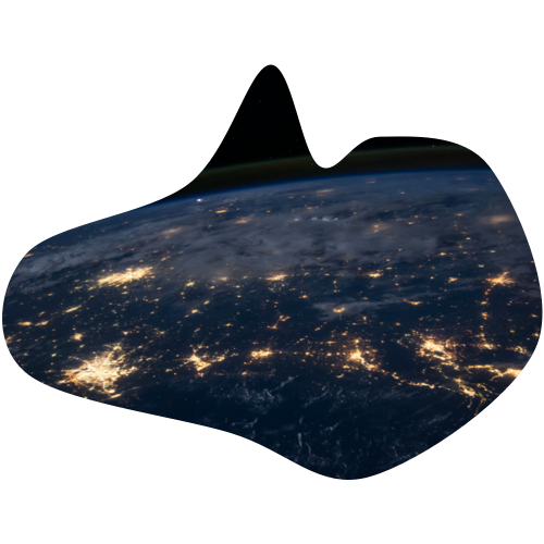 Aerial view of the world at night with city lights on.