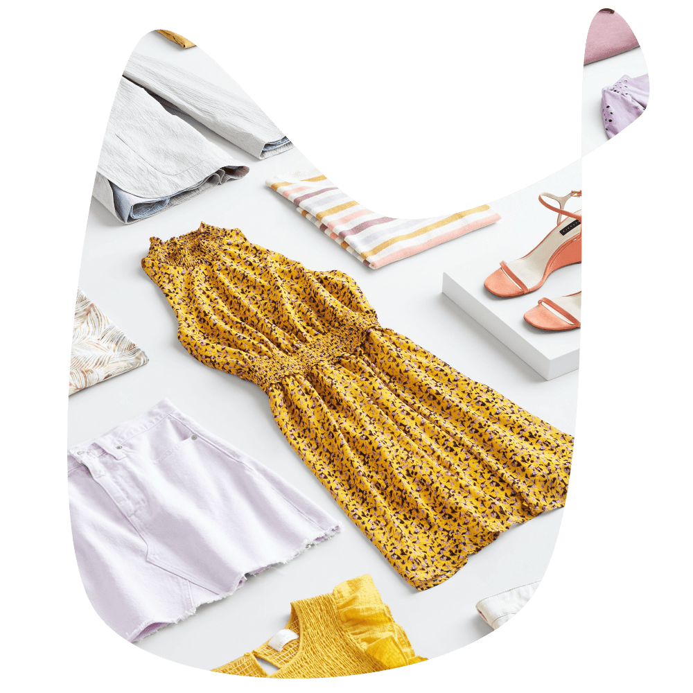 Yellow dress, tank tops, and clothes in a flat lay view