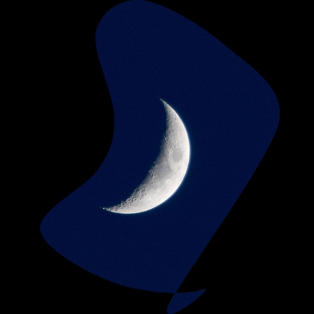 Crescent moon on a dark blue background.