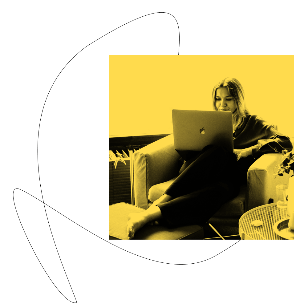 Women sitting on a chair working on her laptop