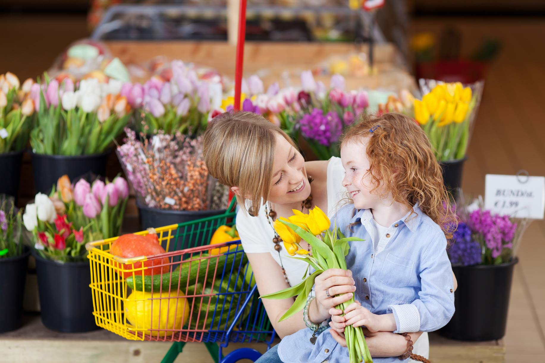 Mother and daughter in mass market florist