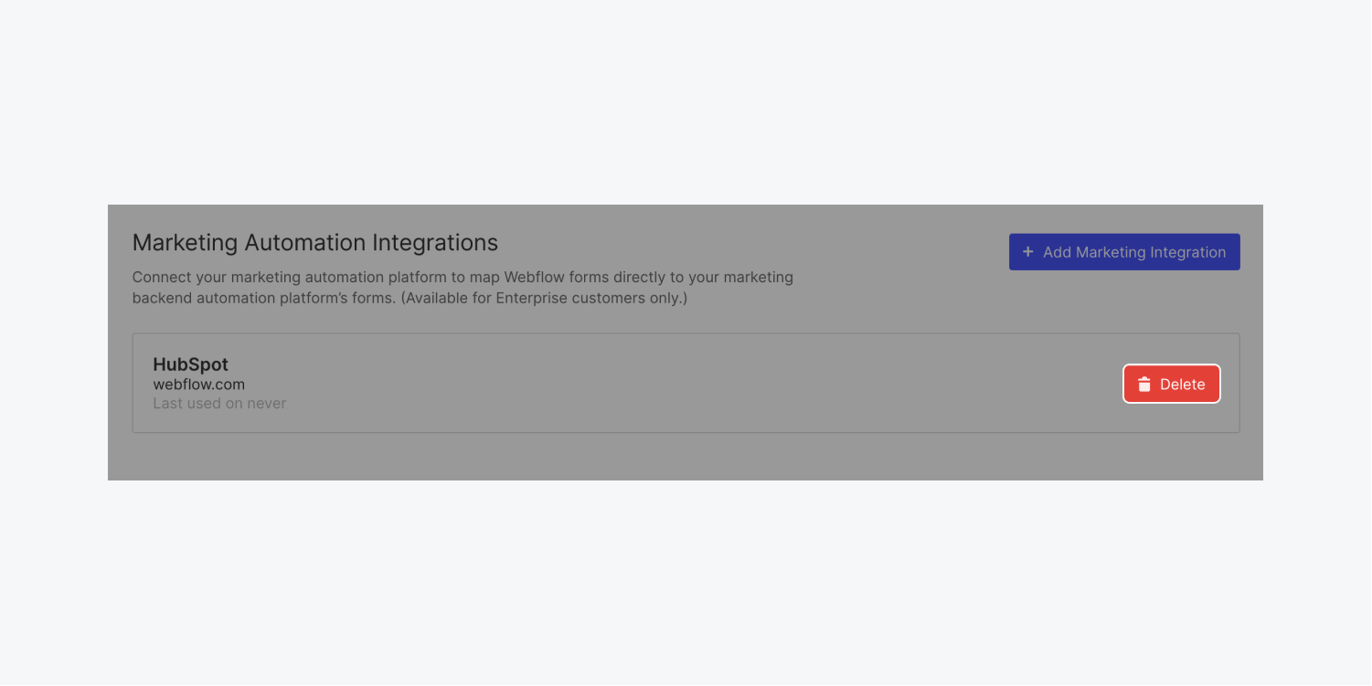 """A """"Delete"""" button is highlighted in the Marketing automation integrations section in Webflow to illustrate how to delete a HubSpot integration."""