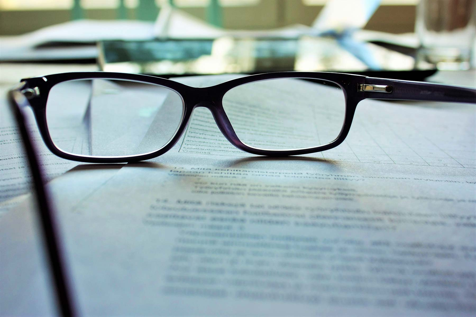 image of freelancer's glasses on table