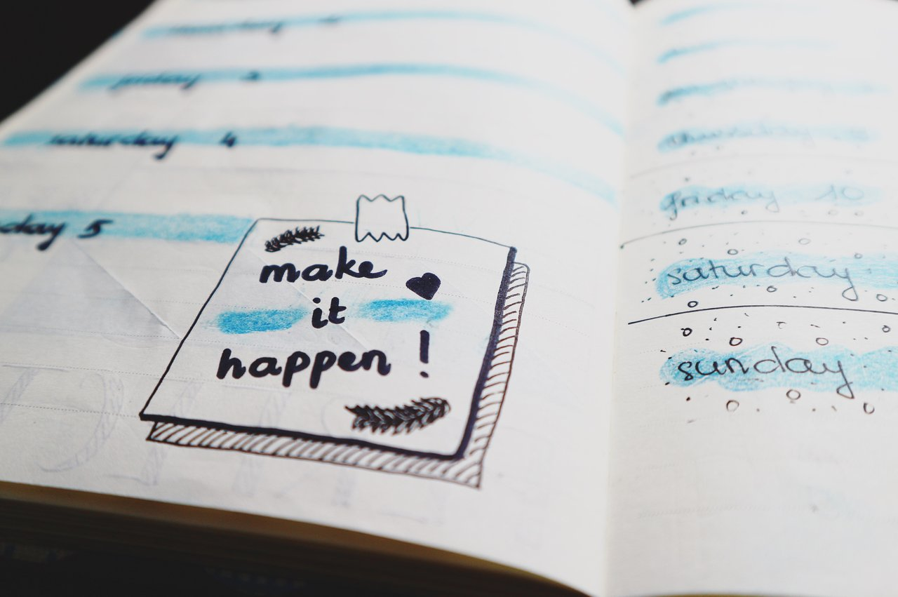 image for freelancers setting goals in a notebook
