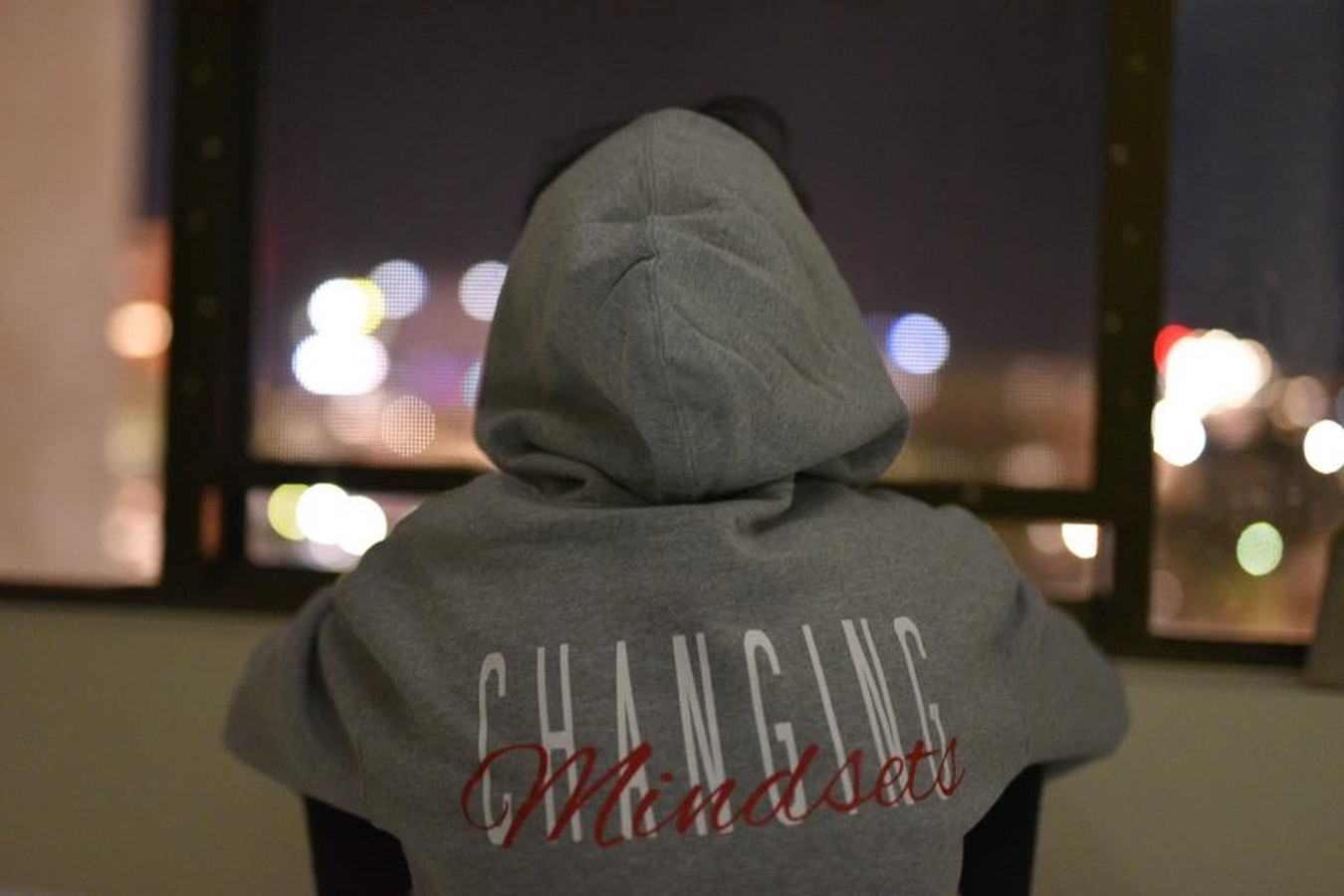 Girl wearing changing mindsets hoodie