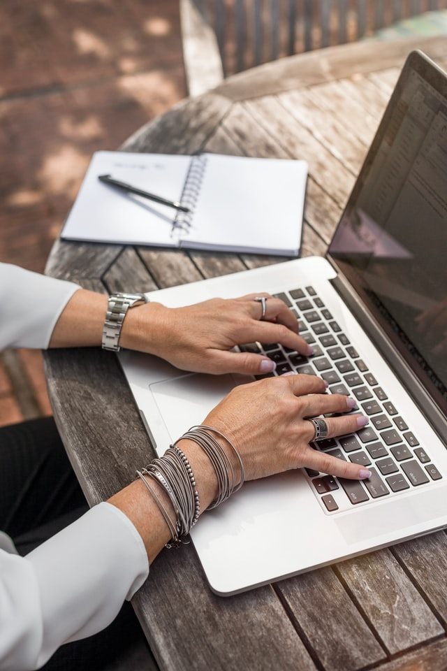 beginner freelance writer typing on laptop