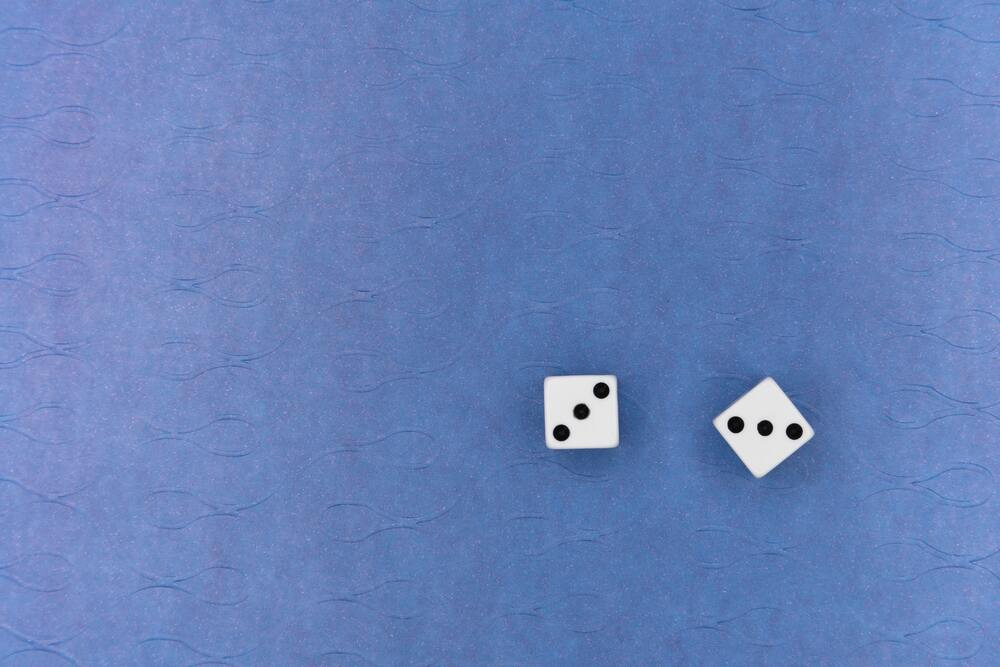 image of dice being rolled